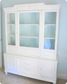 White refinished dining room hutch (back of shelving color too)- with matching off white dining room table- rustic corners