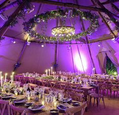 PapaKåta Teepee with 3m floral crown & cartwheel with festoon lights, flowers by The Good Florist, Image by Lloyd Dobbie