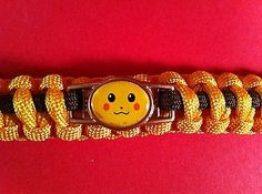 POKEMON PIKACHU BRACELET PARACORD SURVIVAL 550 CORD YELLOW BROWN GOLD CHARM 8.5""