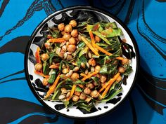 A Paleo-Friendly Roasted Chickpea and Collard Salad | Look for red palm oil in health-food stores, Whole Foods, and online—it is different from palm kernel oil. You may need to melt the red palm oil for it to be tossed evenly and easily with the chickpeas, as well as to incorporate into the dressing. Roasting the chickpeas adds a nice crunch to the salad. Pair this with a piece of grilled meat, and eat the salad immediately, as the oil absorbs quickly into the collards.