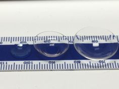 Hybrid lenses are the same size as a soft contact lens making them more familiar to handle.  The lens on the left is a GP lens, the middle lens is a hybrid lens and the lens on the right is a scleral lens.