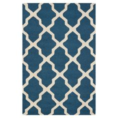 Wool rug with a trellis motif. Hand-tufted in India.    Product: RugConstruction Material: WoolColo...