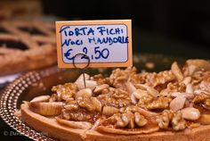 Italy -- 'Torta Fichi Noci Mandorle' by David.Kamm, via Flickr -- A beautiful and delicious dessert made with figs, walnuts, and almonds. Photographed at a market in the Cinque Terre region of Italy.