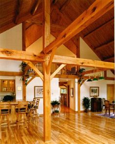 R.L. Merlie Co. - Tour - Exposed Beams of a Timber Frame Home. Gorgeous beams and cathedral ceiling.