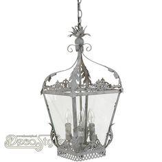 Brocante Hanglamp Seranda Metaal Grijs  Metalen brocante hanglamp. De zijkanten voorzien van glas. Met 4x Kleine fitting (E14).   Kleur: Grijs   Afmetingen lamp zonder ketting: Hoogte: 58 cm Breedte: 29 cm Diepte: 29 cm  Hoogte met ketting: +/- 150 cm