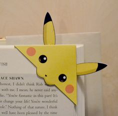 This is a bookmark designed by me, Pokemon inspired fan art. Meant to bite onto … This is a bookmark designed by me, Pokemon inspired fan art. Meant to bite onto the corner of a page. Printed on sturdy card stock. Dimensions: 6 x 6 cm (excluding ears) Paper Crafts Origami, Easy Paper Crafts, Origami Art, Oragami, Funny Pokemon Cards, Pokemon Cards For Sale, Creative Bookmarks, Bookmarks Kids, Corner Bookmarks