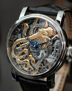Give your look some nautical flair by accenting it with this lovely octopus watch. Designed by master watchmaker Stefan Kudoke, this stunning skeleton frame watch displays an exquisitely intricate octopus intertwined along the watch's inner workings. Octopus Watch, Cool Watches, Watches For Men, Wrist Watches, Nixon Watches, Pocket Watches, Casual Watches, Watch Engraving, Skeleton Watches