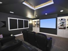 Family-Friendly Home Theaters: In this dramatic home theater, you can watch movies any time of the day. All-black walls and shades prevent screen glare from sunlight and ensure a top-quality movie-watching experience. From DIYnetwork.com