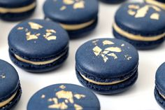 Gorgeous, Creme Brûlée macarons in navy with accents of gold leaf.