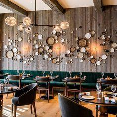 Designers designed the interiors for Fiskebar, a Nordic restaurant at the luxury Hotel de le Paix, located on Lake Geneva.
