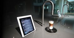 Scanomat has introduced their newest and coolest product yet - the Top Brewer.  This machine brews any coffee beverage in 45 seconds, has no grinders, can be operated by an iPad or iPhone and even cleans itself.