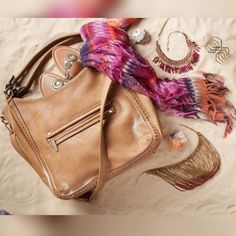 Beautiful Buckskin Colored Handbag Gorgeous tan hobo bag.  Gold studded detailing and hardware.  Has shorter handles, and adjustable, removable longer strap, so you can wear as a crossover bag.  Excellent, like new condition. Maurices Bags Hobos