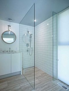 Oversized floor tile. White subway tile in the shower. Sustainable Clearview Residence Overlooking A Pond: freshomeinterior.com