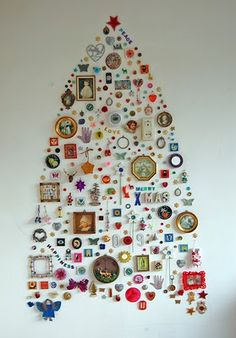 A Christmas Tree made from personal mementos and cherished nic-nacs :: I adore this idea!
