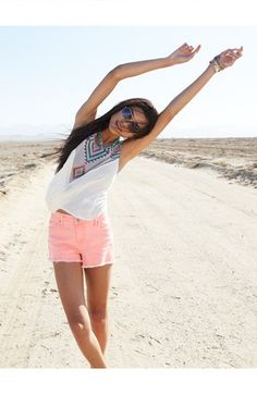 Style Tip: Pair bright coral cutoff shorts with a patterned tank for a desert ready, music festival look.