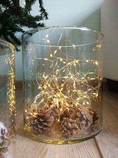 Some pinecones accompanied by magic warm light make great decoration for cozy Christmas time evenings