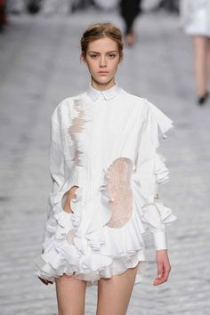 Beautiful cut-outs and ruffle detailing at @Viktor_And_Rolf #PFW WGSN on tumblr. They said cut-outs would be all the rage, and they are.