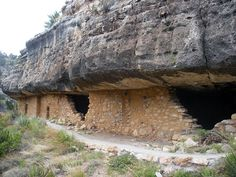 At Walnut Canyon National monument you can walk along the cliff path and go inside the cliff dwellings.  See the soot from ancient fires and some cliff drawings.