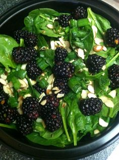 Organic baby spinach, blackberries, raw almonds, and scallions with some apple cider vinegar.