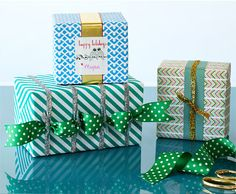 Present Perfect - Start with wrapping paper  in bright patterns and layer on metallic ribbons  for joyful and dazzling presentations. To make it feel  extra fun, add on ribbon in a contrasting pattern.