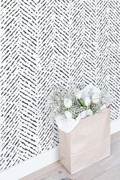 Herringbone wallpaper is one of the top picks for a feature wall in a nursery. Either in bold Navy or subtle Greys, the look is fabulous! It is also a safe choice for a gender neutral nursery, as herringbone pairs perfectly with subtle shades.
