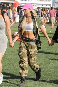 Hiding in the shadows: She wore camouflage as she held her girlfriends' hands...
