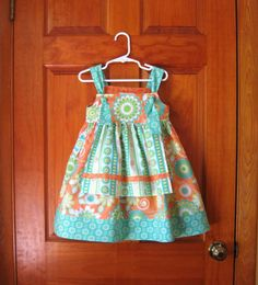 Girl toddler apron knot dress with ruffled pants turquoise, orange and green Size 4/4T. $40.00, via Etsy.