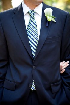 I consider myself to be anti-black suit. I love navy suits. Paired with a green tie, it'd be perfect!!