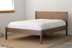 """Solid Walnut Queen Bed Frame And Headboard Price range $1,295 - $1,595 Constructed with mortise and tenon joinery. Fits a standard, 60"""" x 80..."""