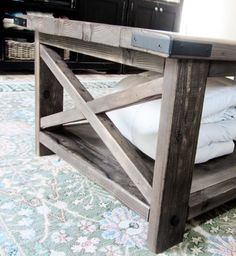 Using basic plans from Ana White, I created this custom DIY coffee table in an afternoon - by It's big, it's solid and best of all, it's easy! Diy Coffee Table Plans, X Coffee Table, Solid Wood Coffee Table, Rustic Coffee Tables, Decorating Coffee Tables, Rustic Table, Rustic Wood, Diy Furniture Plans, Farmhouse Furniture
