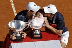 Bob & Mike Bryan pose with their Monte Carlo winner's trophy and Bob's daughter, Micaela.