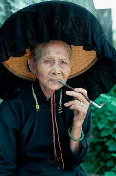 Hakka Woman Smoking Pipe. China