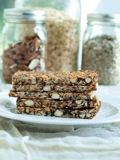 Homemade Easy Fruit, Nut, and Seed Granola Bars.  These healthy homemade granola bars have no refined sugar and are full of goodness! A great portable snack to have on hand.  Clean-eating recipe.