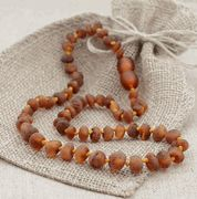 Amber teething necklace. When in doubt, put amber on it. My same philosophy as with colloidal silver :)