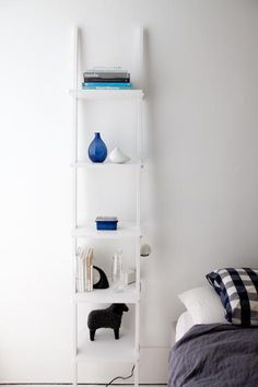 light leaning bookcase as bedside table for extra storage