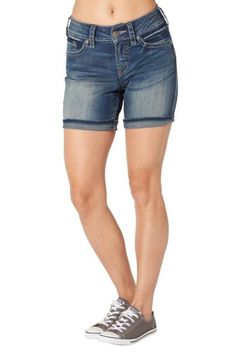 """Suki mid-rise shorts in do-anything Super Stretch denim hug those curves and waist, so there's no gapping. Lightweight and oh-so-soft, this Super Stretch fabric will stand up to whatever you throw at it. These dark-wash shorts have a subtle faded look. Signature back pockets keep it simple with a cool contrast stitch.Inseam: 6.5"""" Unrolled; 4.5"""" Rolled.   Suki Mid-Thigh Shorts by Silver Jeans Co.. Clothing - Shorts - Denim North Shore, Boston, Massachusetts"""