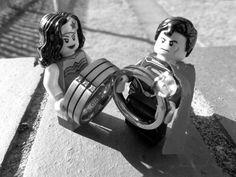 "Our ""engagement"" photo! Lego engagement geeky love superhero wonder woman superman rings"