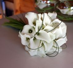 Hand tied bridal bouquet with crystal blush calla lilies and looped flexi grass www.vanillarose.co.uk