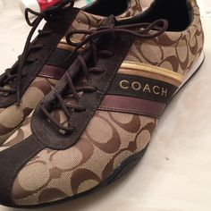 Never worn authentic COACH sneakers COACH sneakers. Never been worn!!  Beautiful tones of brown and gold! Coach Shoes Sneakers