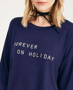 "<p>This super cute pullover features a soft knit body, ""Forever On Holiday"" embroidered at the front, dropped shoulder seams, a relaxed fit, and banded ribbed knit trim.</p>    <p>Model is 5'7"" and wears a size small.</p>    <ul>  	<li>Round Neckline</li>  	<li>Long Sleeves</li>  	<li>Lightweight</li>  	<li>23.25"" From Shoulder to Hem</li>  	<li>Polyester / Rayon / Spandex</li>  	<li>Hand Wash</li>  	<li>Imported</li>  </ul>"