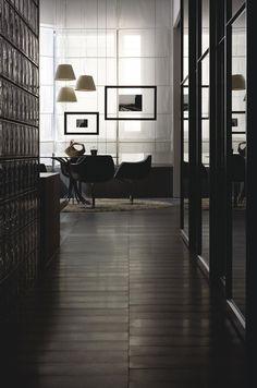 Design By Mauro Lipparini Dark corridor. Glass bricks. Intimate. Minimal. Dark floor tile. Nice tile pattern. Soft light. Masculine interior.