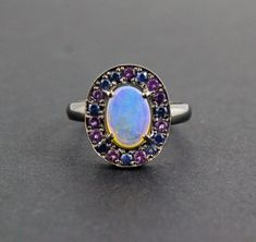 Excited to share the latest addition to my #etsy shop: Australian jelly opal with amethyst and blue sapphire halo in oxidized black gold ring size 6.5 - Ready to ship or Resize http://etsy.me/2p7r4zV #jewelry #ring #blue #black #opalring #opalengagementring #haloring #