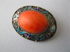 A 1940's - 50's Chinese silver filigree and natural Coral brooch.