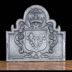 Antique 19th century cast iron arch shaped rectangular fire back, cast with crowned shield with three fleur-de-lys.