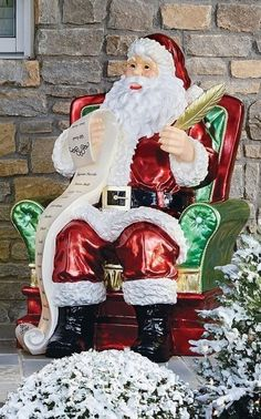 Adorned with 10 LED lights, our exclusive Santa looks comfortable reclining in his chair while he reads over his list. This handpainted Santa makes a fun and festive addition to any indoor or outdoor holiday display. Tiered Server, Wreath Hanger, Lawn Ornaments, Metallic Paint, Great Movies, Festive, Landscaping, Santa, Indoor
