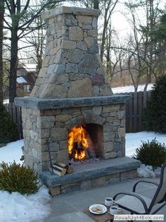 Patio With Outdoor Fireplace Natural Stone Around The Fire And Also On The Seat Wall
