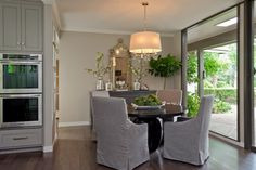 Slip-cover chairs. Castle Hills Kitchen by CROSS CONSTRUCTION CO. - contemporary - Dining Room - Other Metro - Cross Construction Company