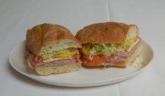 Italian Submarine-Salami, Ham, Mortadella, Provolone Cheese, Pepperoncini with Lettuce, Tomato, Italian Dressing on Submarine Bun