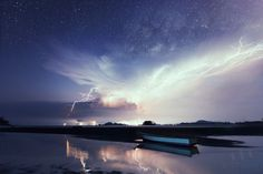 The rise of the Milky Way and a spectacular lightning display in Mersing, Malaysia on June 28, 2014. Credit and copyright: Justin Ng.