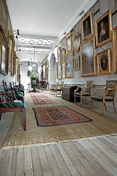 The Long Gallery, so called in English country houses.  On the frequent rainy days these were used for taking exercise.  Note the limed oak floor boards & the reed matting.